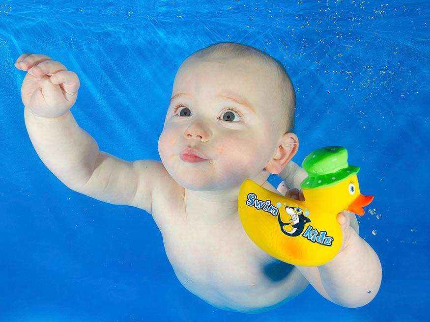Baby swims with mum at Swimkidz swimming lessons