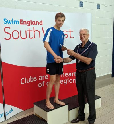 Connor receiving a Swimming Award